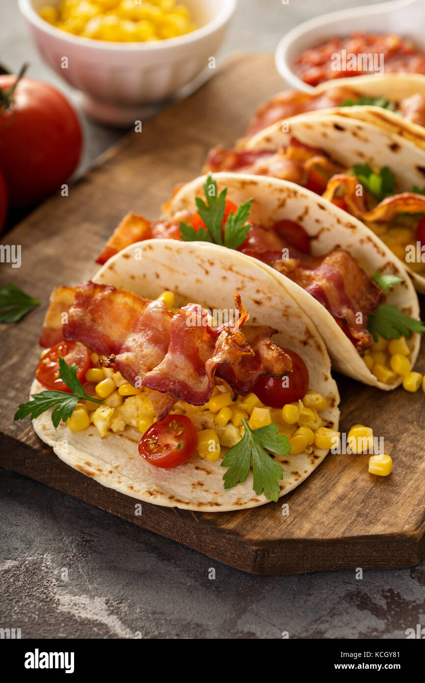Breakfast tacos with scrambled eggs and bacon - Stock Image