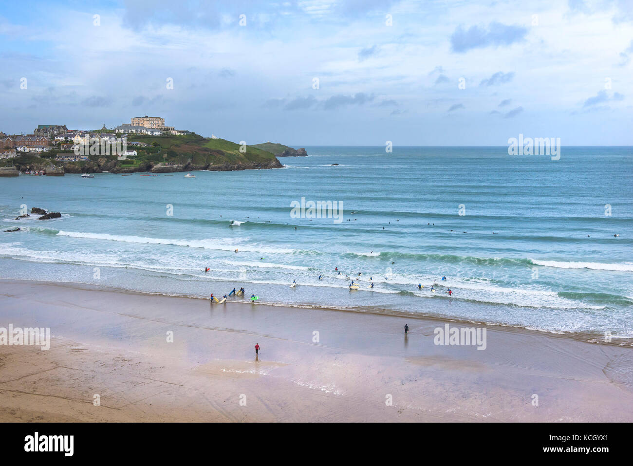 Surfing in Cornwall - surfing activity on Great Western Beach in Newquay, Cornwall. - Stock Image