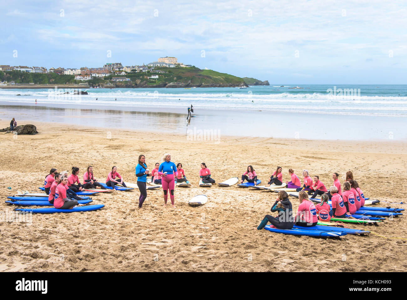 Beginners attending a surfing lesson - Surf Betty's Festival a festival held in Newquay to help empower women through - Stock Image
