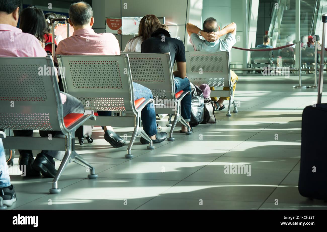 Kota Kinabalu, Malaysia - September 06, 2017: Traveler waiting to board at the departure lounge in Kota Kinabalu - Stock Image