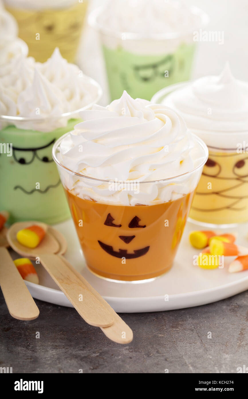 Funny Halloween themed puddings in cups - Stock Image