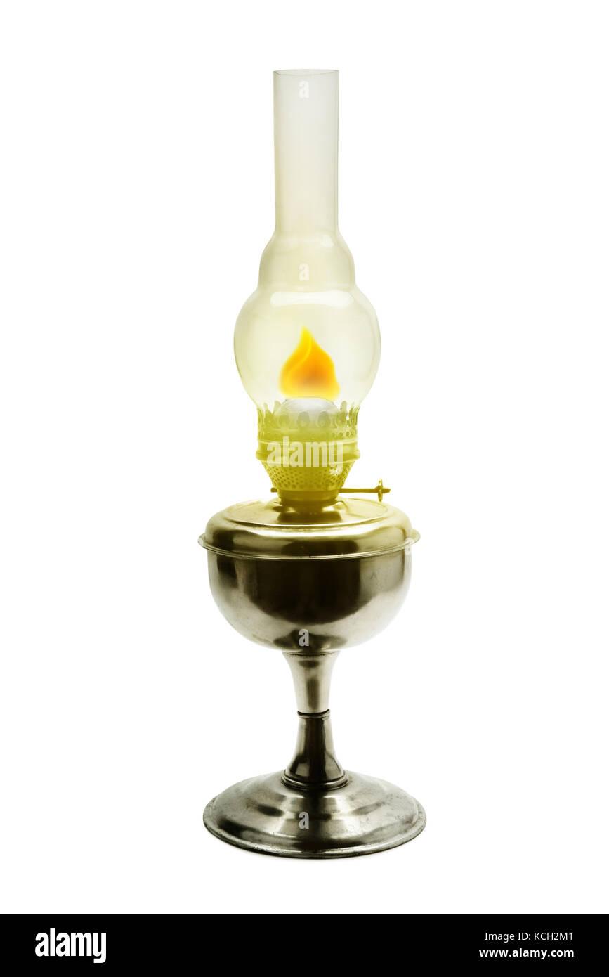 Burning kerosene lamp isolated on white - Stock Image