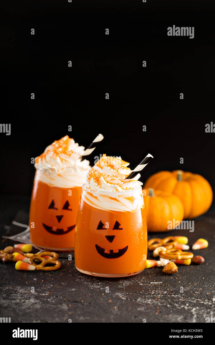 Halloween cold cocktail or drink with jack o'lantern face - Stock Image