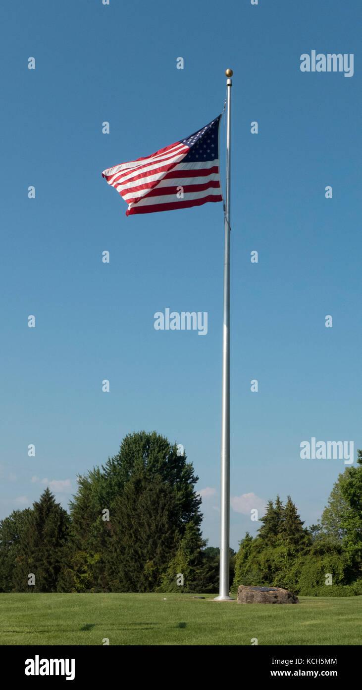 Flagpole flying Stars and Stripes. - Stock Image