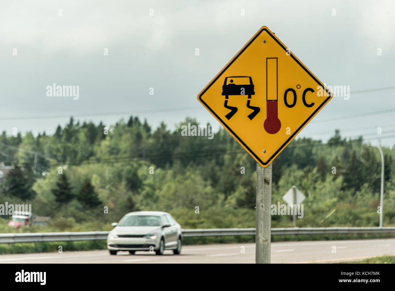 warning sign for slippery icy road on trans canada - Stock Image