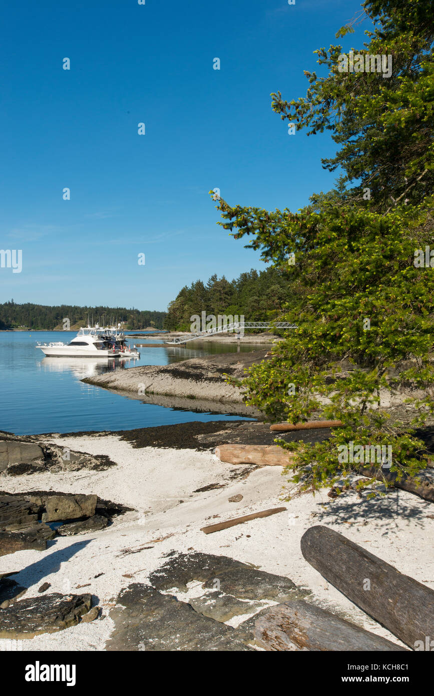 Anchored boats at Gulf Islands National Park Reserve, Portland Island, British Columbia, Canada - Stock Image