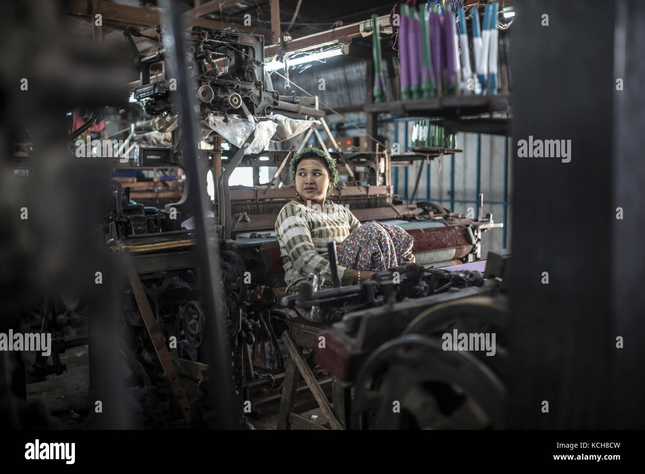 MANDALAY, MYANMAR - JANUARY 11, 2016: Unidentified woman in a small silk factory on the outskirts of Mandalay, Myanmar - Stock Image
