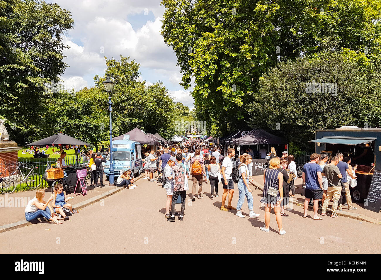 LONDON, ENGLAND - AUGUST 6, 2017; Crowd flocks to Victoria Park Saturday Market in lovely summer day to socialise - Stock Image
