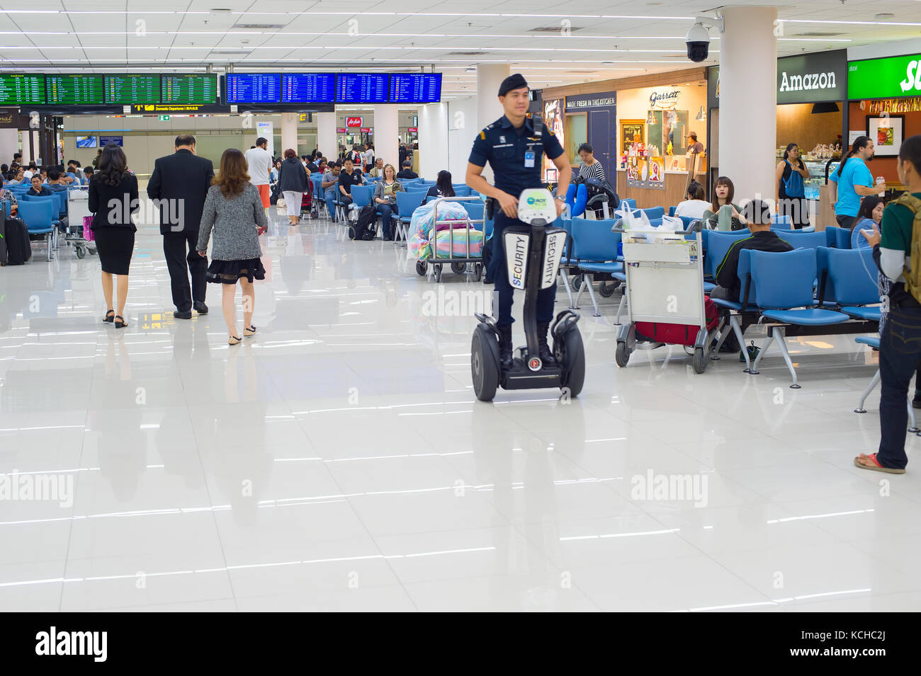 BANGKOK, THAILAND - JANUARY 13, 2017: Passengers at waiting room in the Don Mueang airport. The airport is considered - Stock Image