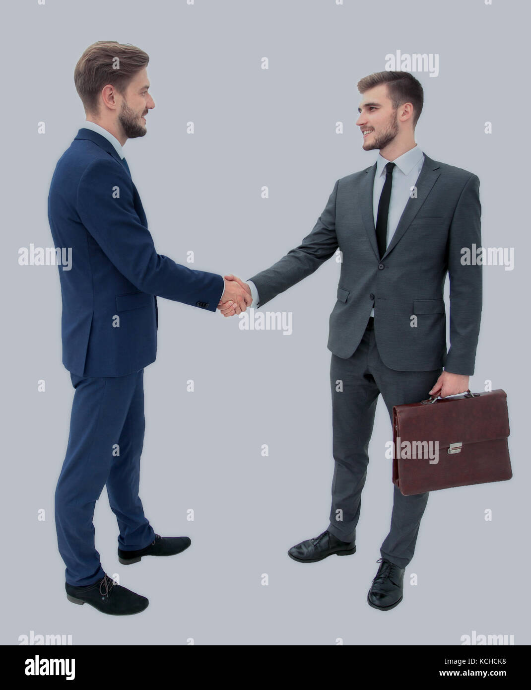 lawyer shaking hands with client welcoming him at the meeting - Stock Image
