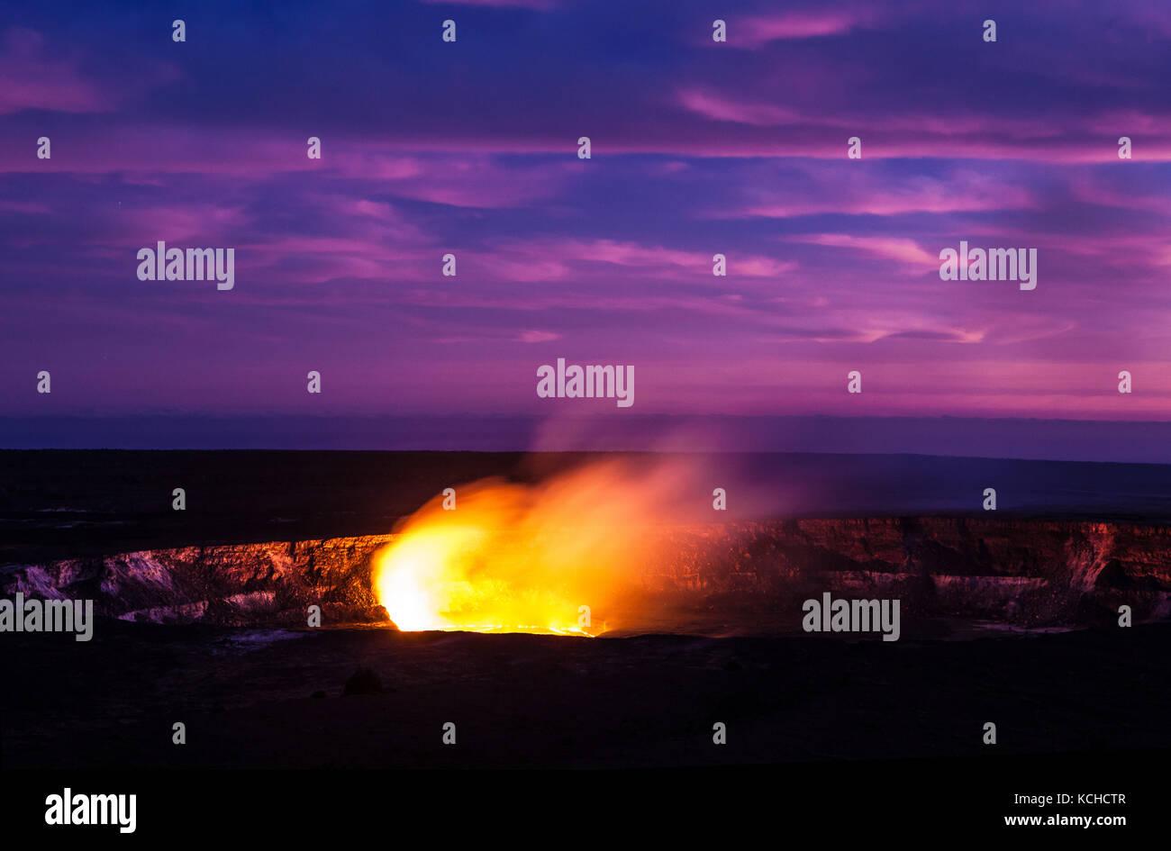Eruption, Halema'uma'u Crater of Kilauea Volcano in the evening, Island of Hawaii - Stock Image