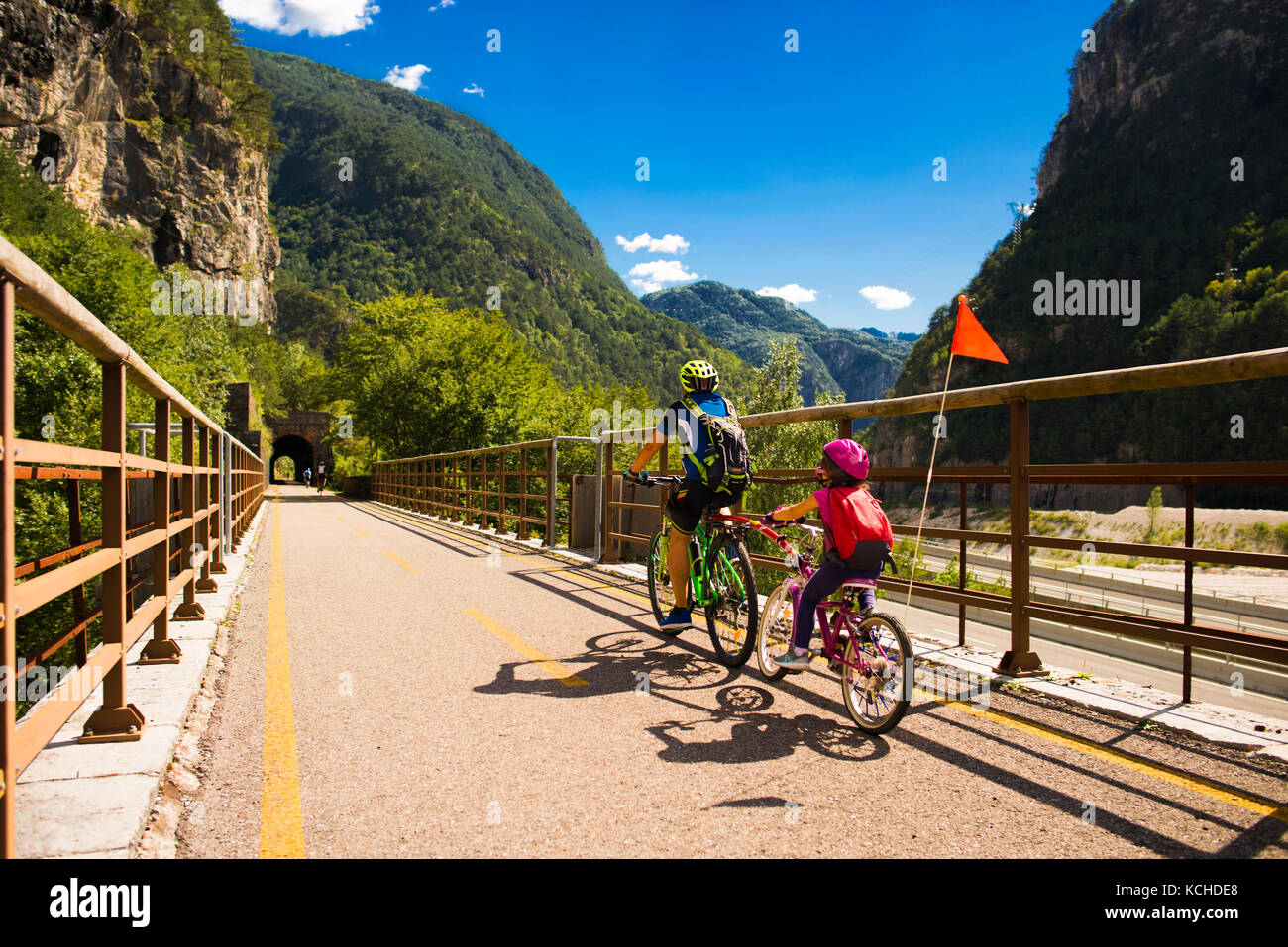 Tandem of father and daughter, family cycling in Alpe Adria itinerary - Friuli-Venezia Giulia, Italy - Stock Image