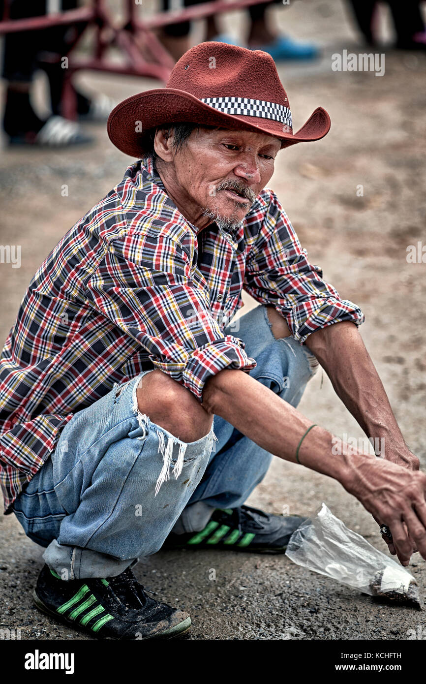 Elderly Thailand man squatting and crouching down. Asian people. - Stock Image