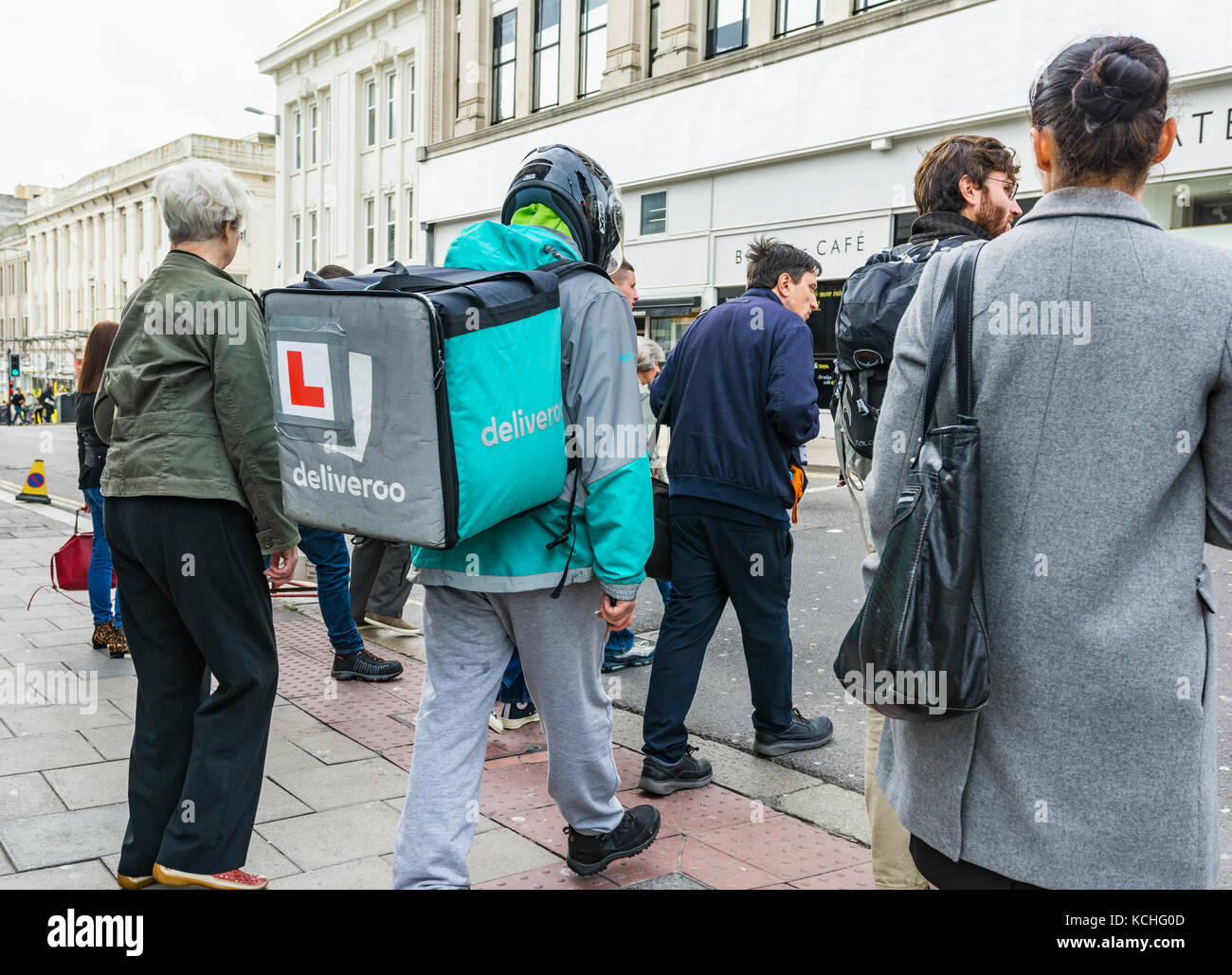 Deliveroo employee on food with a Deliveroo backpack in Brighton, East Sussex, England, UK. - Stock Image