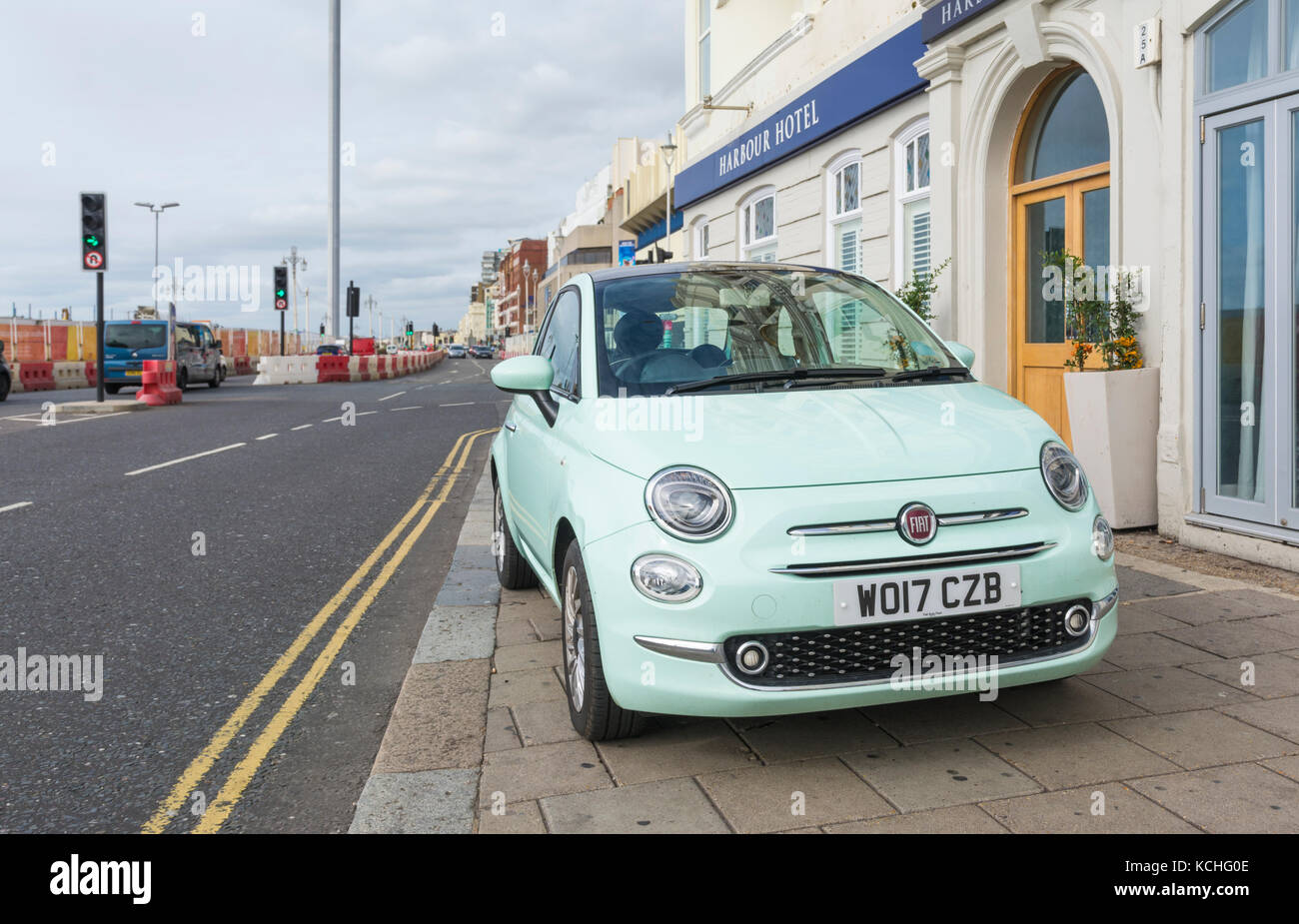 Car parked on a pavement in the UK. - Stock Image