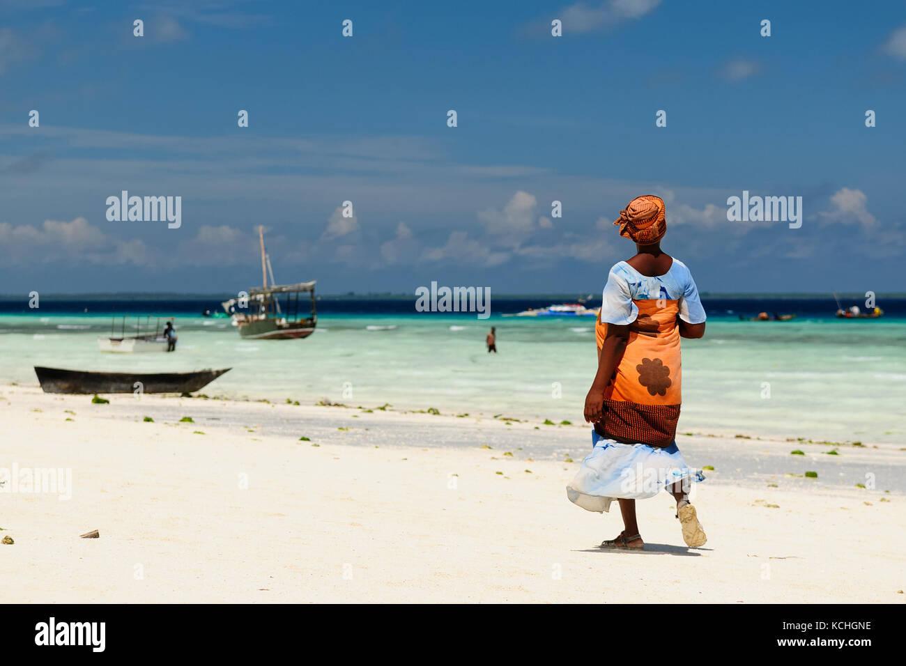 Ethnic women on the beautiful beach on the  Zanzibar island, Tanzania, Africa - Stock Image