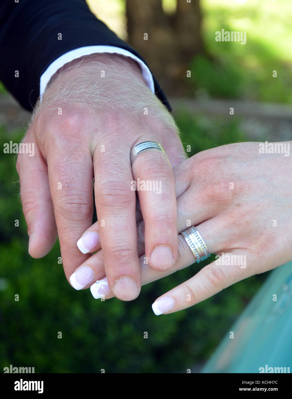 picture of a hands of a bride and groom with wedding rings - Stock Image