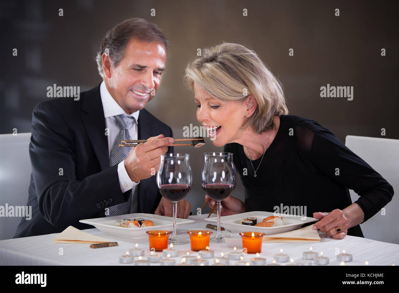 Romantic Mature Couple Having Dinner At Restaurant - Stock Image