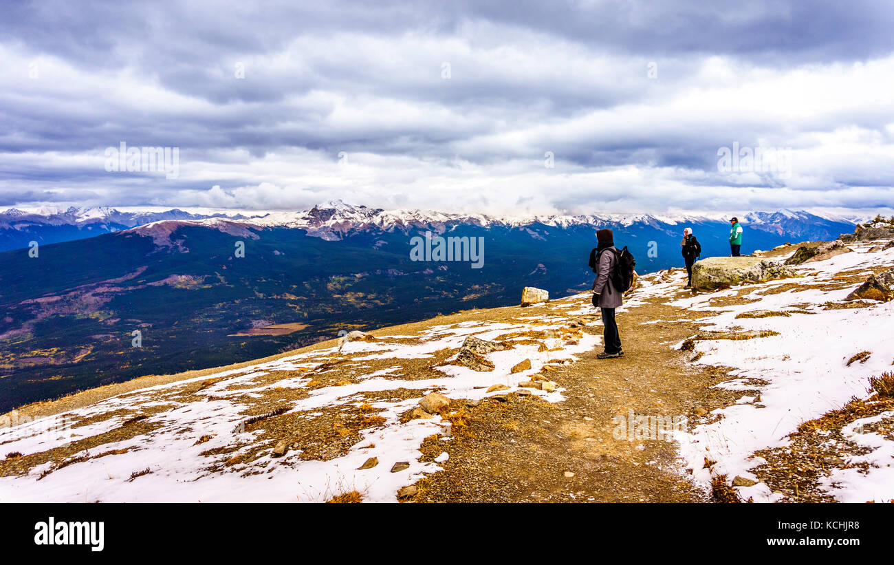 Seniors Hiking on top of The Whistlers mountain in Jasper National Park in the Canadian Rockies on cold September - Stock Image