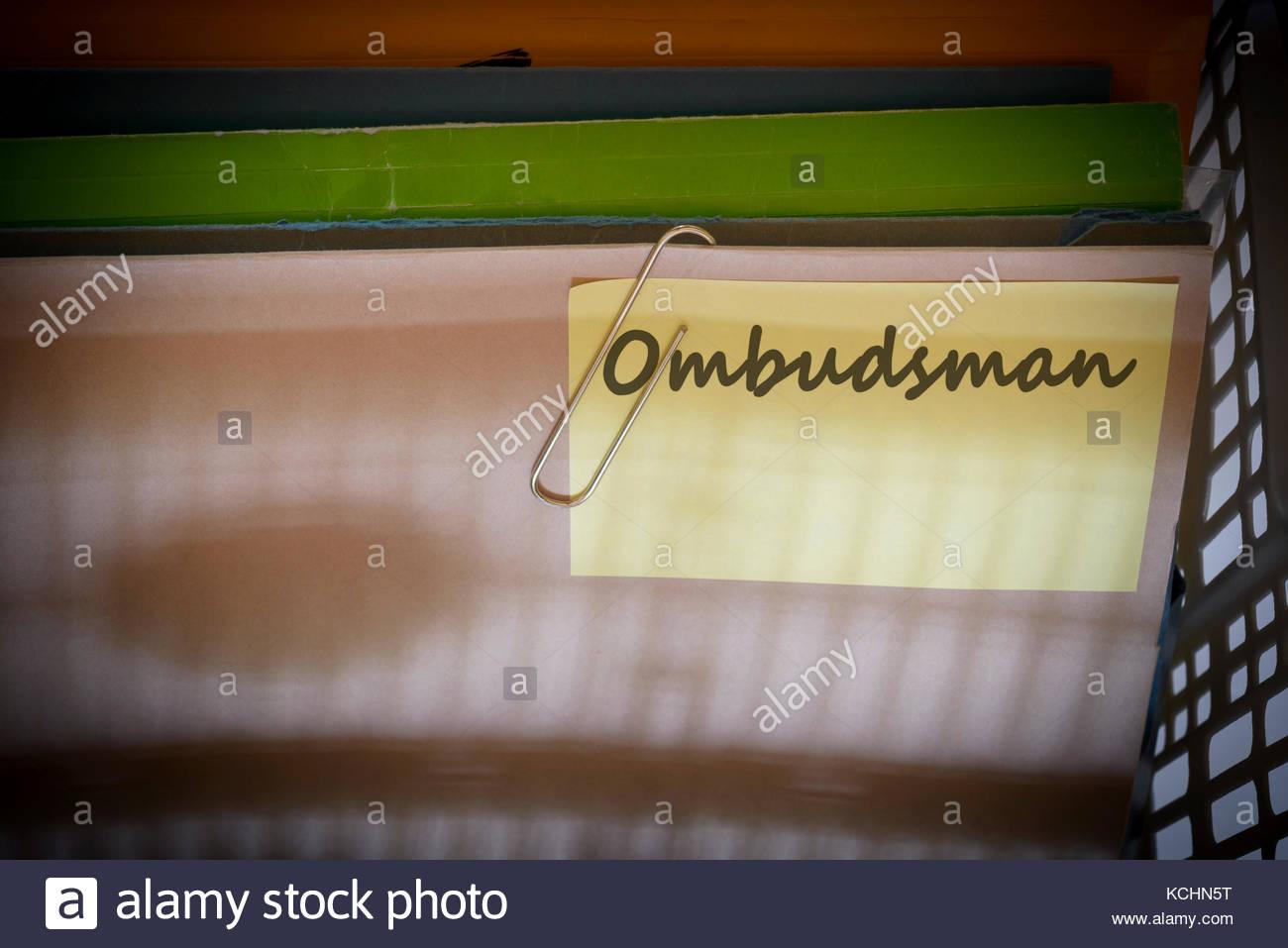 Ombudsman written on document folder, Dorset, England. - Stock Image