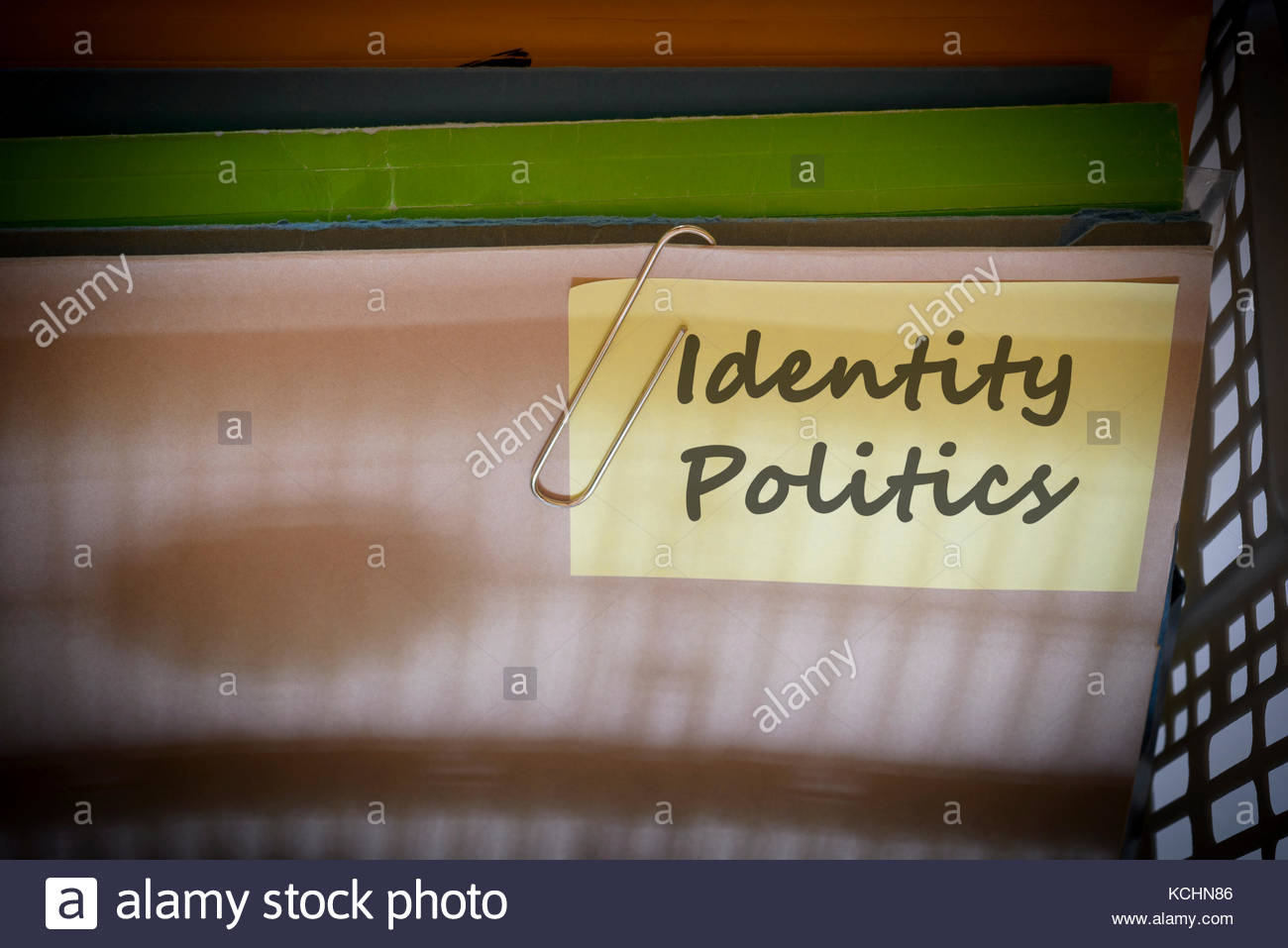 Identity Politics written on document folder, Dorset, England. - Stock Image