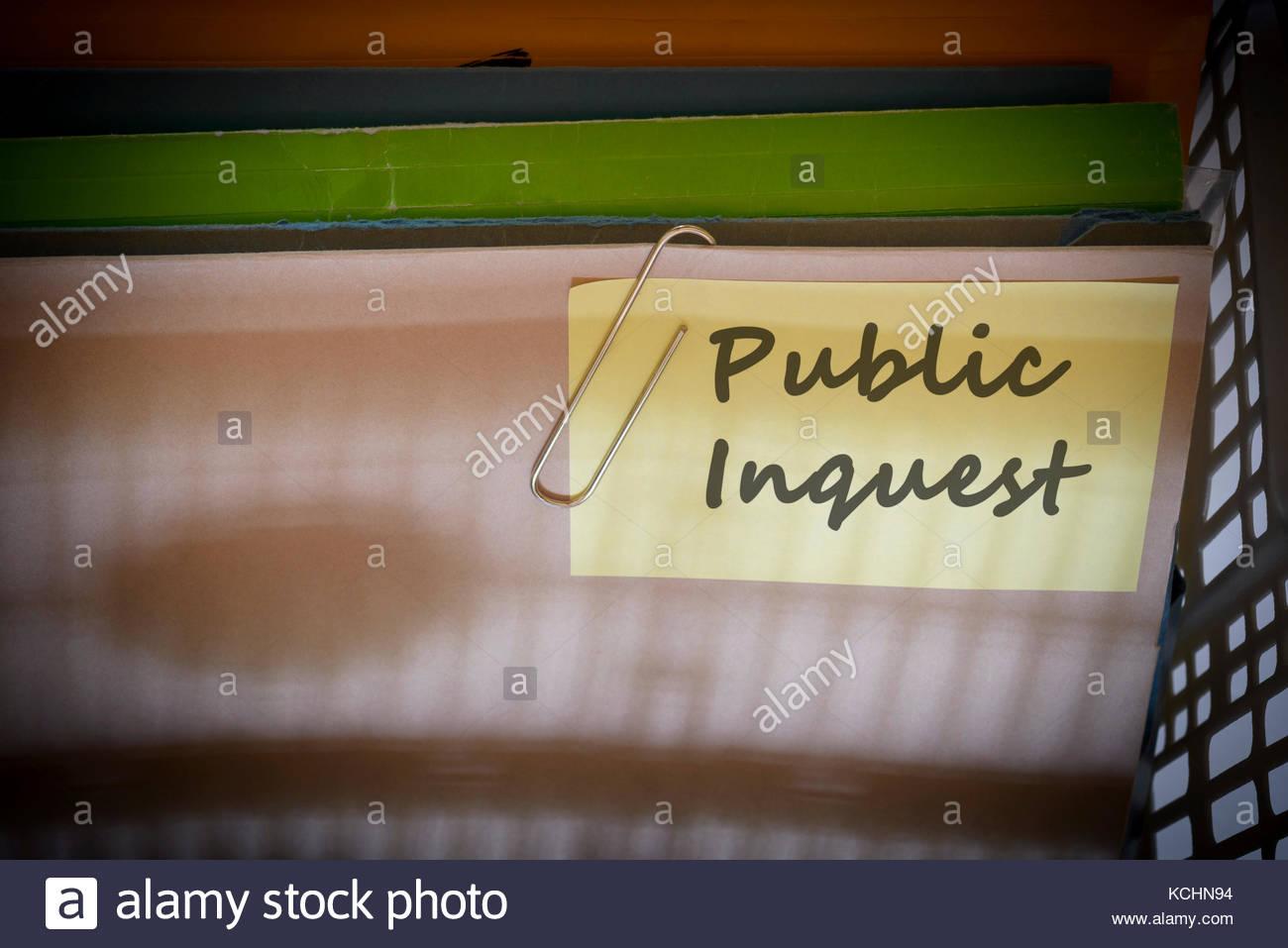 Public Inquest written on document folder, Dorset, England. - Stock Image