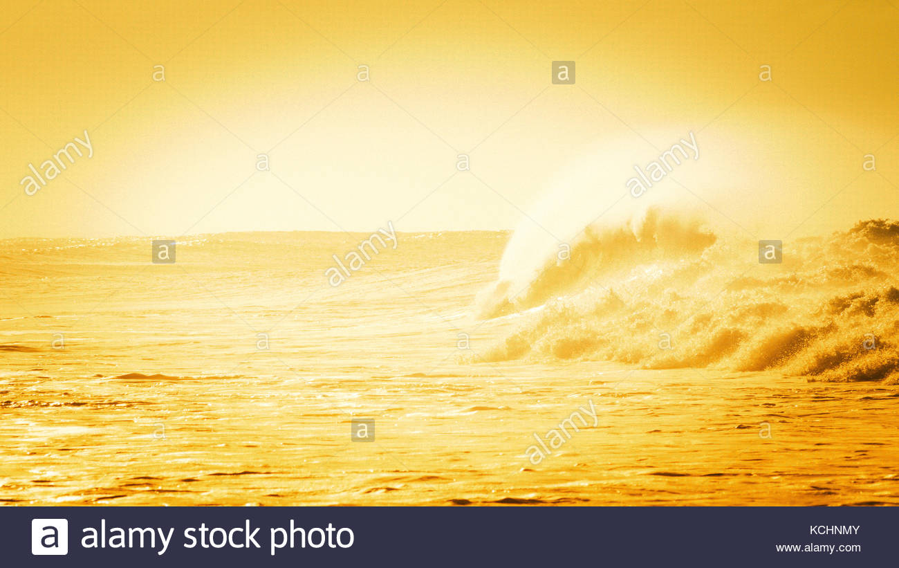 Large wave breaking out to sea - Stock Image