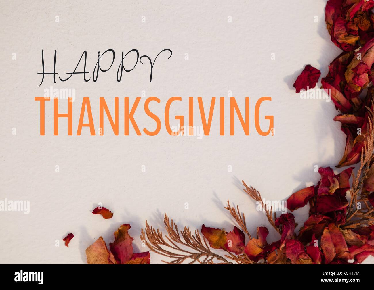 Digital composite of Happy thanksgiving text with dried Autumn flowers Stock Photo