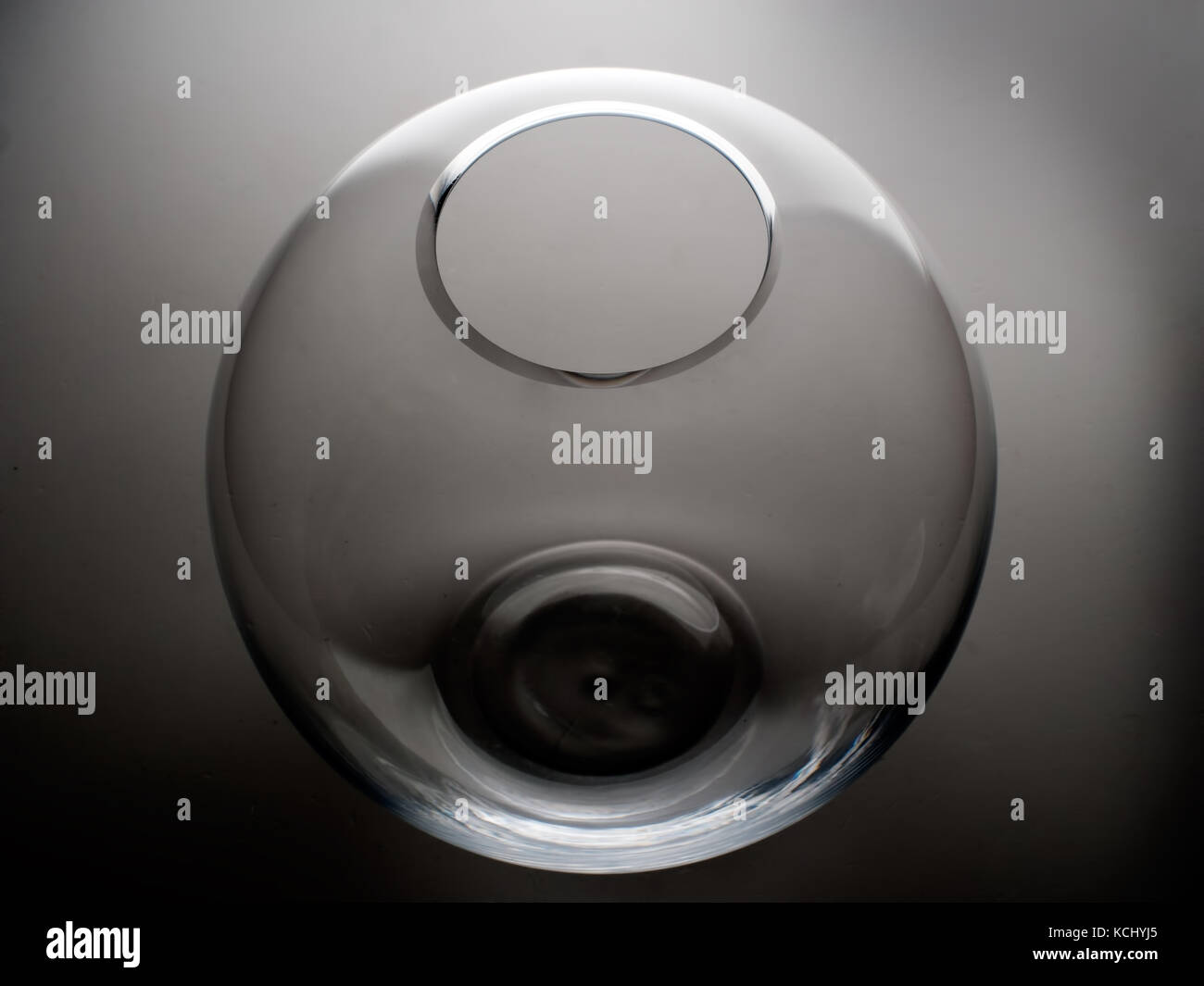 Empty goldfish bowl from an unusual angle - abstract. - Stock Image
