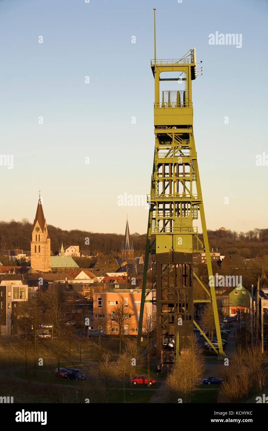 Germany, Ruhr area, Castrop-Rauxel, headgear of the disused coal-mine Erin, view to the old part of Castrop.  Deutschland, - Stock Image