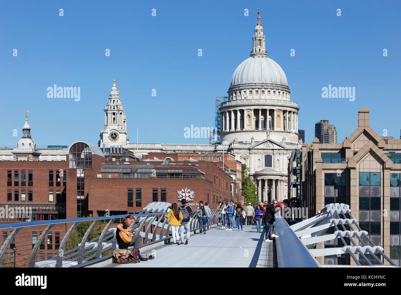 LONDON - SEPTEMBER 2017; People on the Millennium Bridge with St Paul's Cathedral on the background. - Stock Image