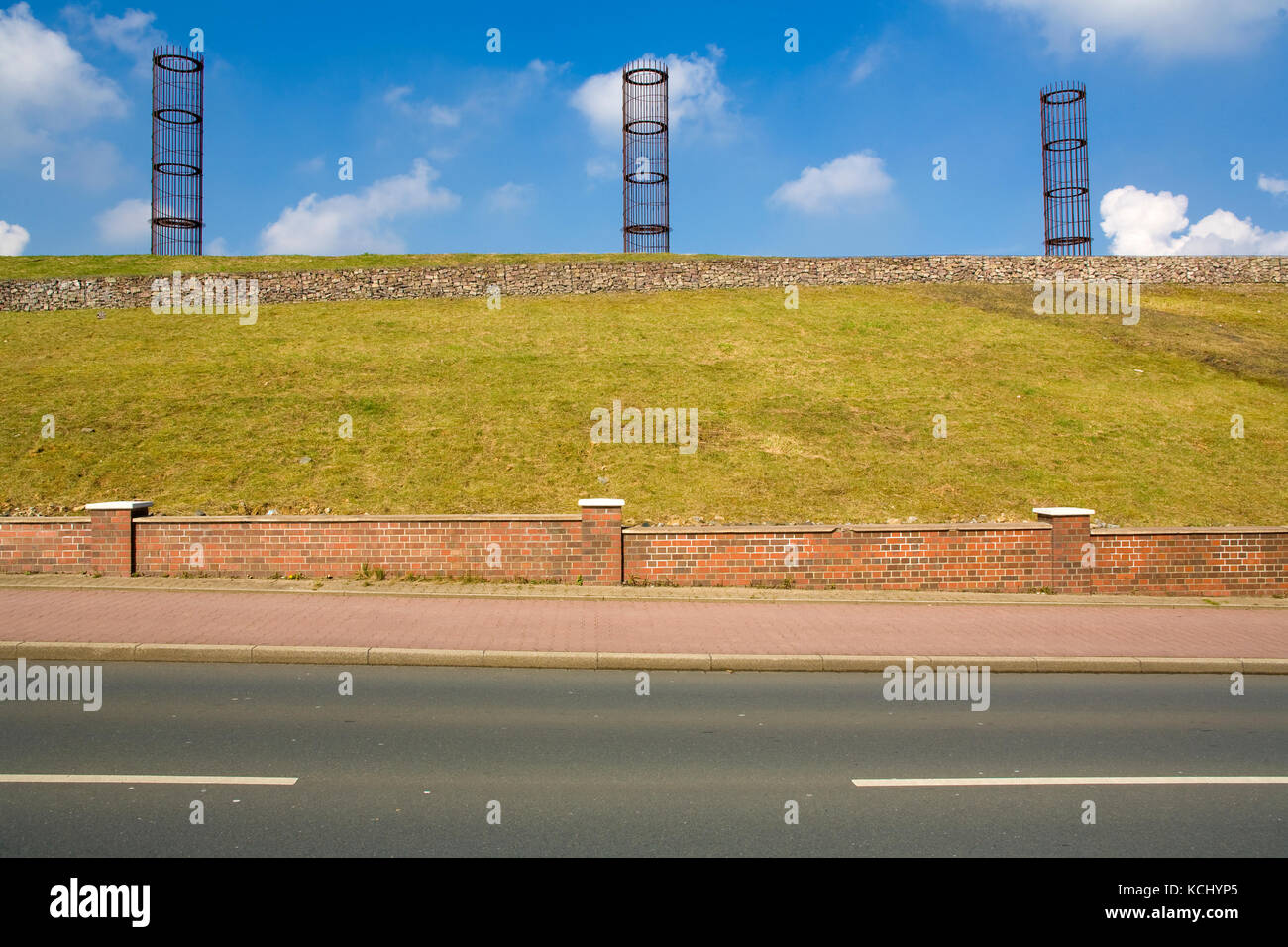 Germany, Ruhr area, Bochum-Gerthe, installation art 'The three big men' on top of a heap of the former coal - Stock Image