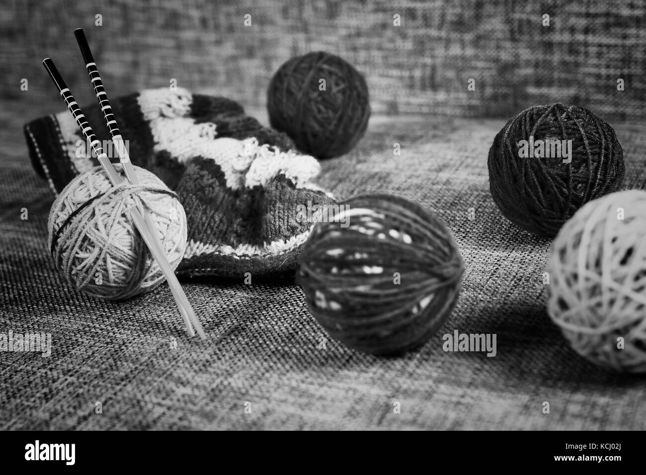 embroidery wool balls and knitting needles - Stock Image