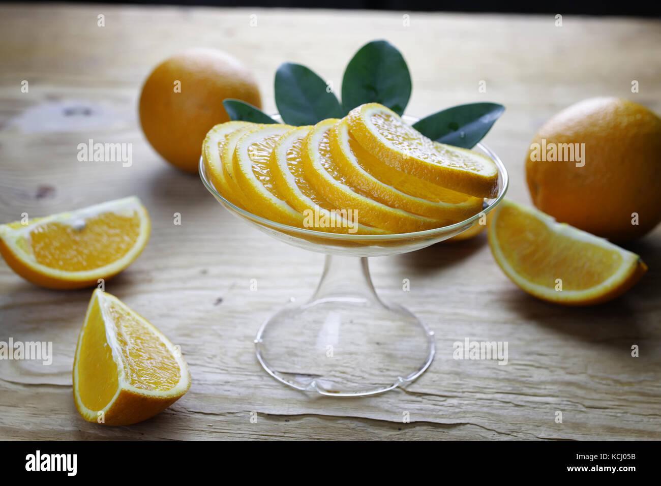 orange fruit wooden background - Stock Image