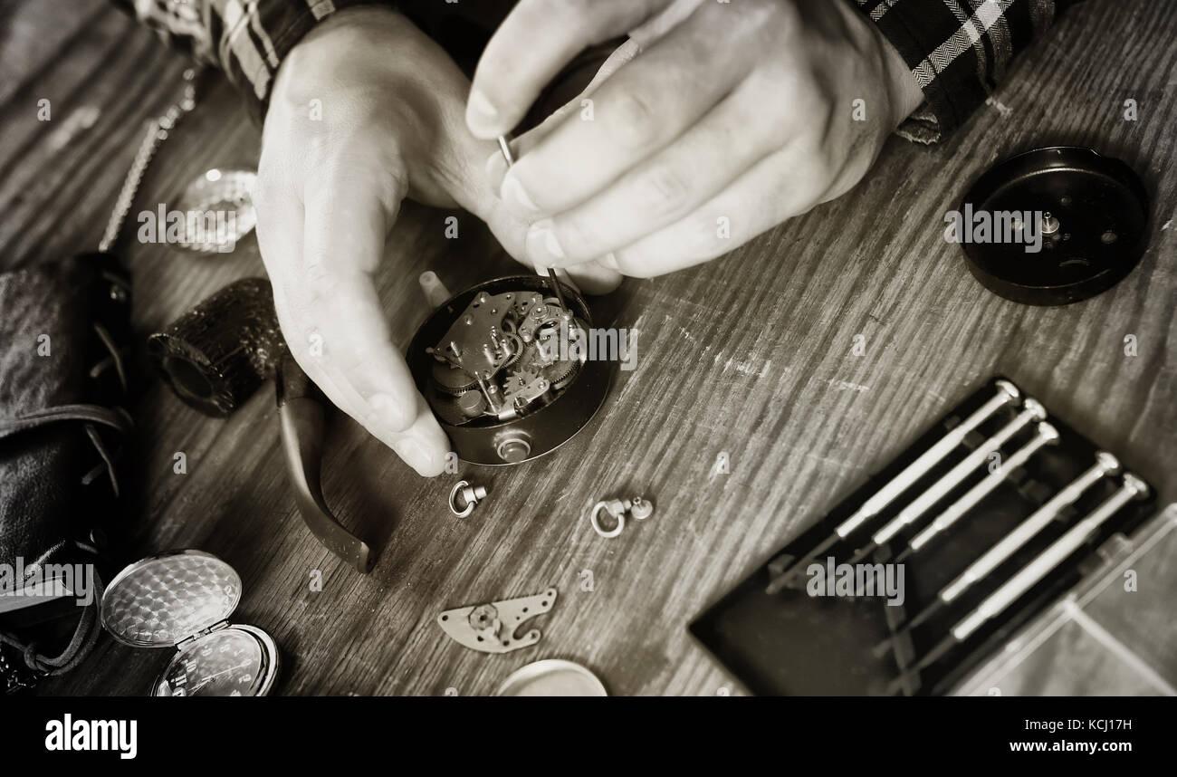 black and white photo watch clock repairing - Stock Image