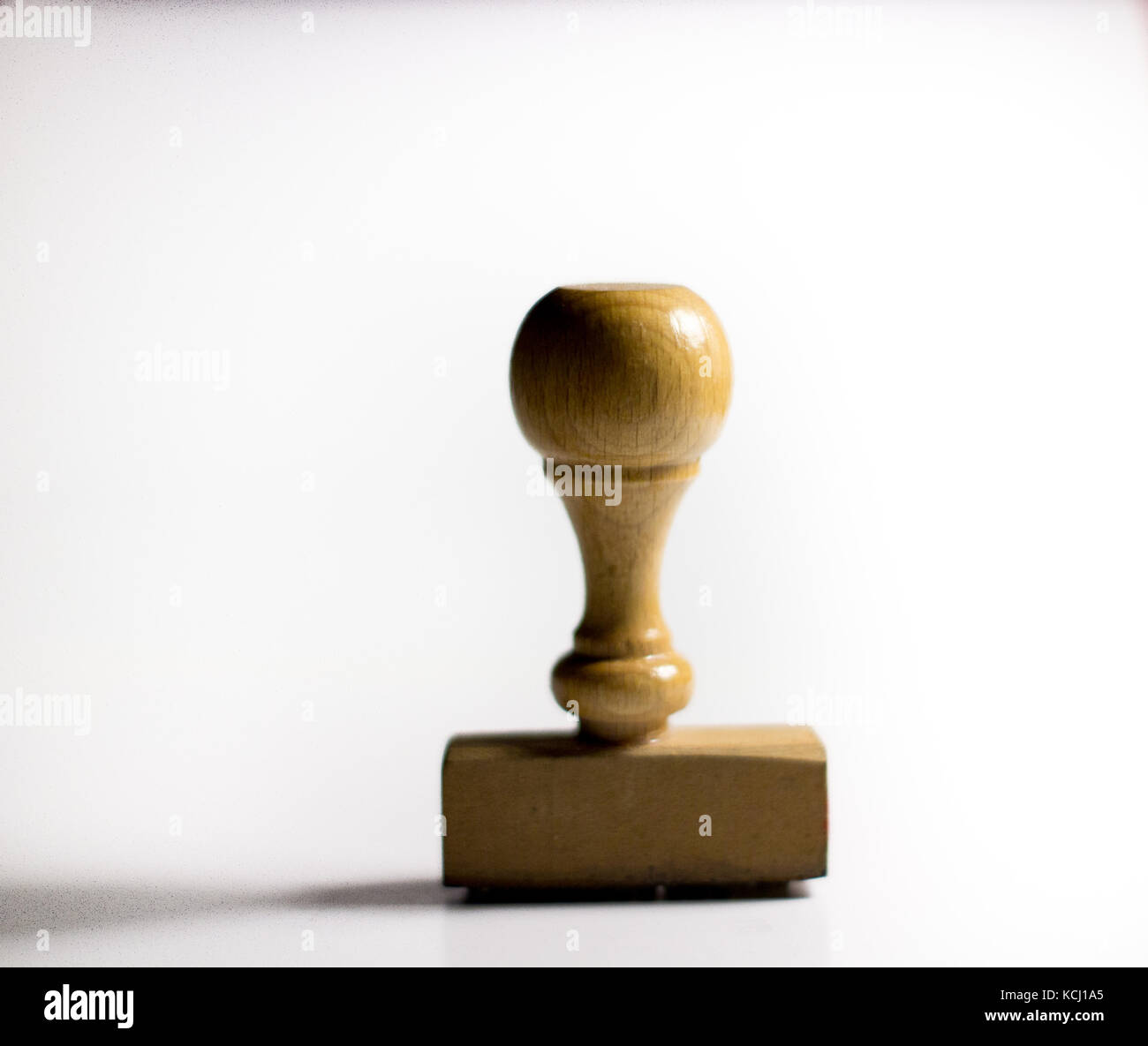an office stamper on a white background waiting to approve some papers Stock Photo