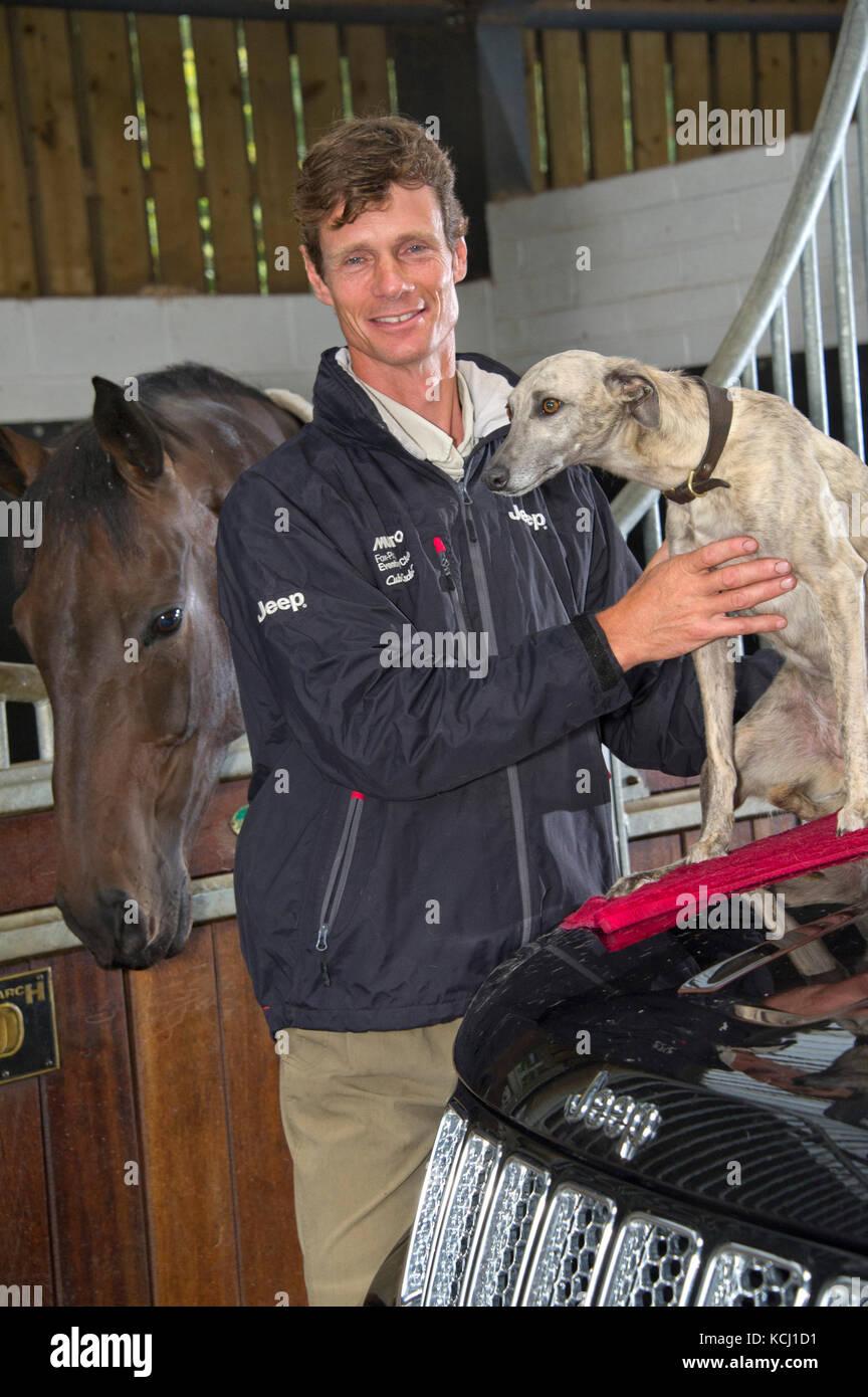 Equestrian William Fox-Pitt with his dog 'Poppy' - Stock Image