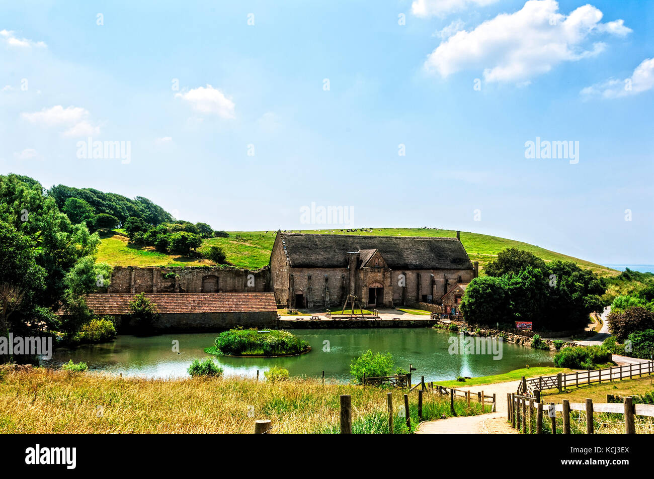 A well preserved 14th century tithe barn which survived the dissolution of the monasteries because of its usefulness - Stock Image