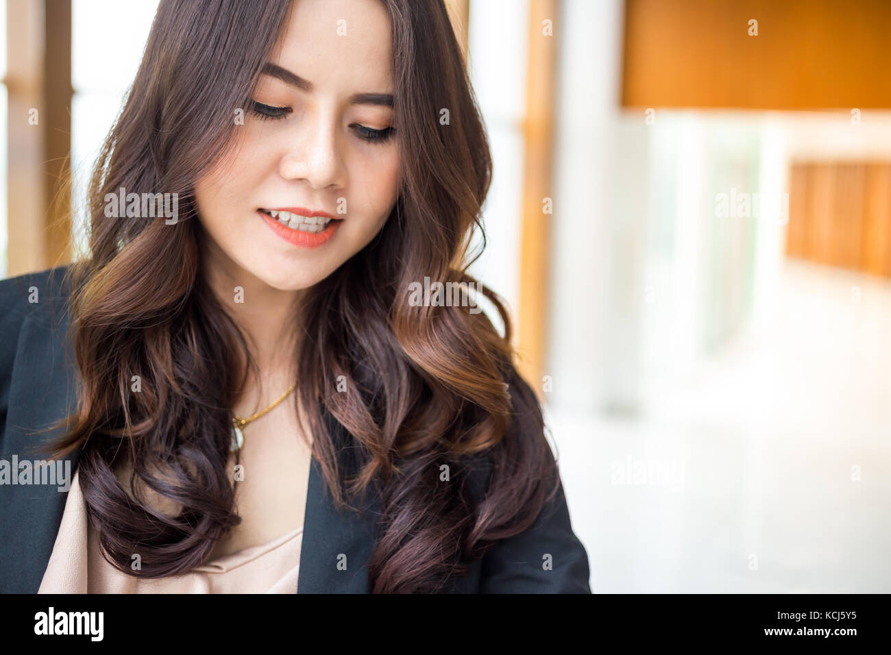 Beautiful Asia business woman over blue office background. Stock Photo