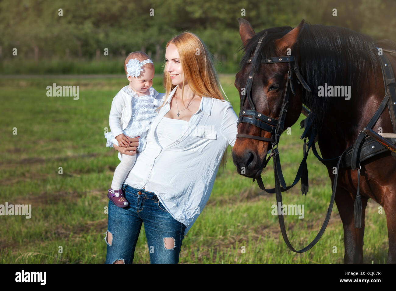 Mother And Daughter Standing Near A Horse Mom Looks Into The Stock Photo Alamy