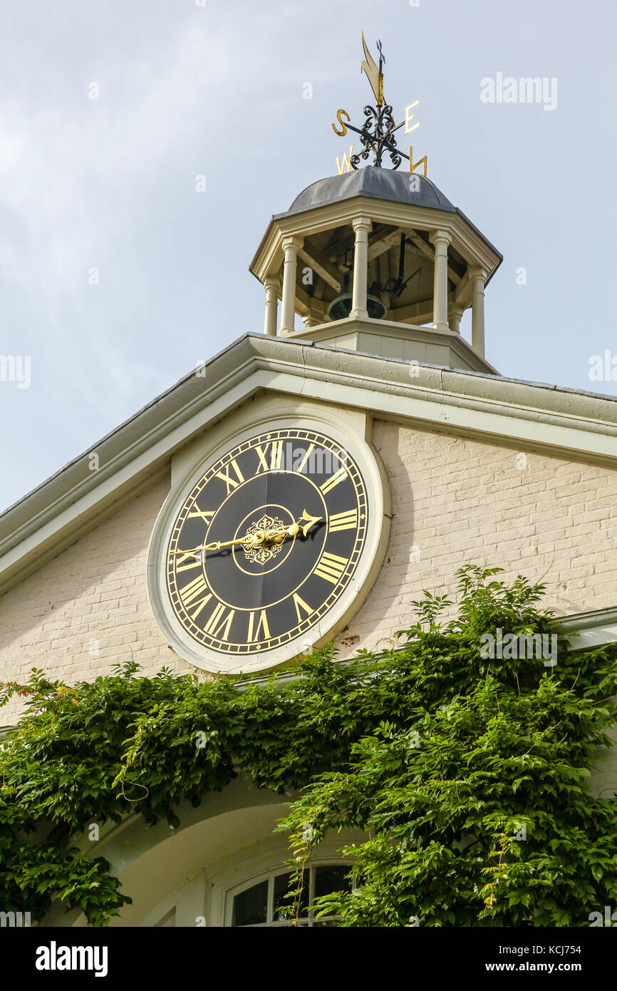 The clock and cupola on the stable block at Shugborough Hall, near to Stafford, Staffordshire, England, UK - Stock Image