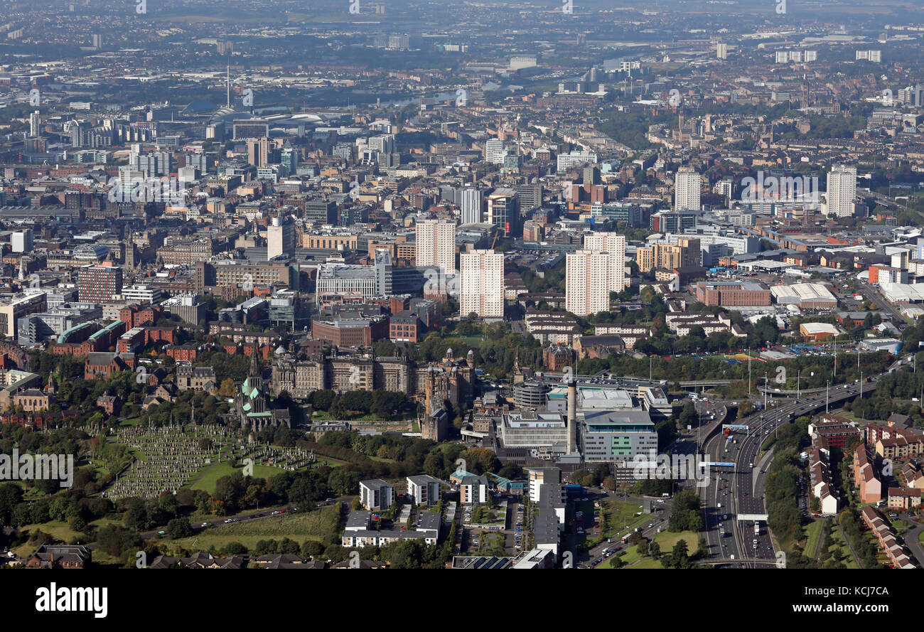 aerial view of Glasgow city centre skyline from the east, with the Royal Infirmary, Cathedral & Necropolis in - Stock Image