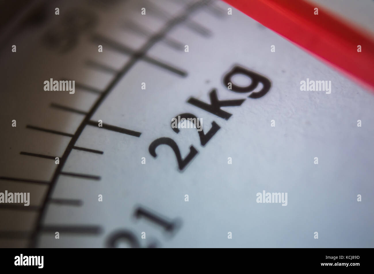 Close up of a scale with 22kg showing up. - Stock Image