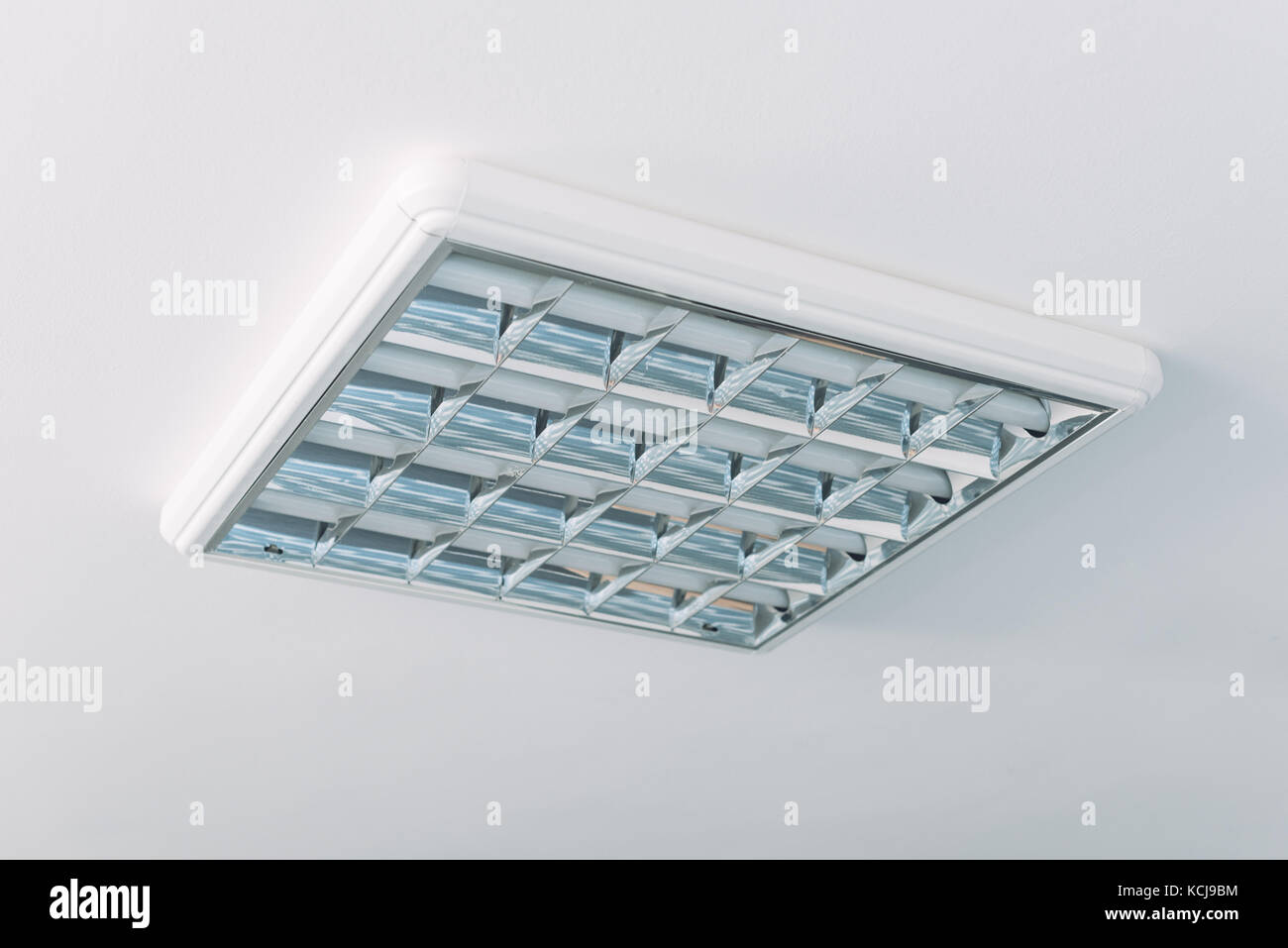 Fluorescent ceiling lights stock photos fluorescent ceiling lights ceiling neon tube lights in bright room interior stock image aloadofball Image collections