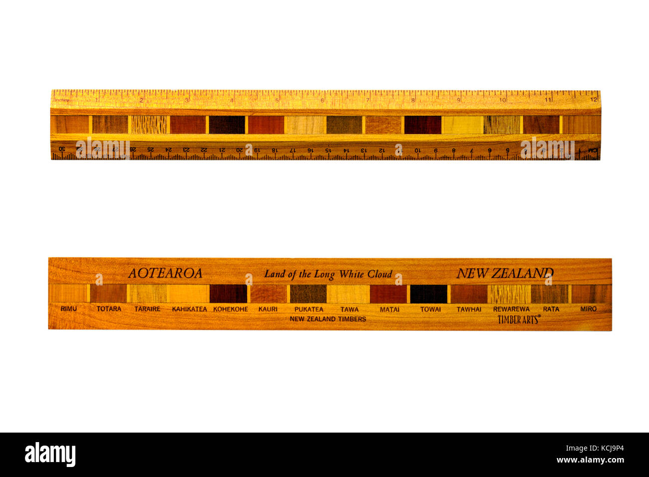 Land of the long white cloud - wooden ruler made with New Zealand timbers showing front and back of ruler - timber - Stock Image