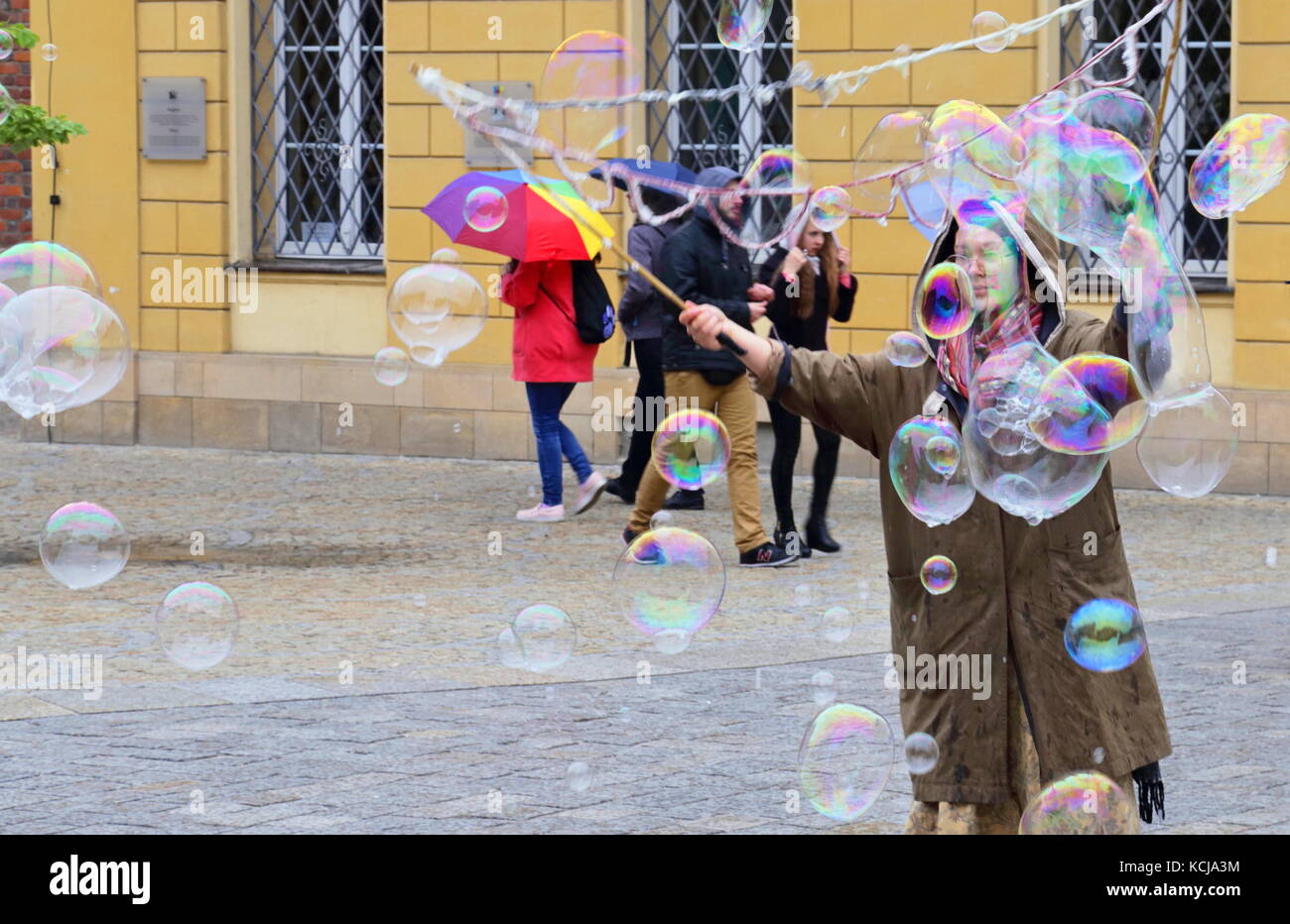Woman performing soap bubbles spectacle in Wroclaw, Poland - Stock Image