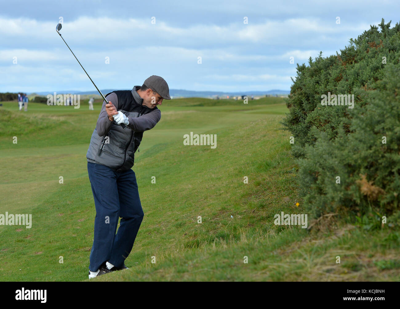 Wladimir Klitschko takes a shot off the fairway during day one of the Alfred Dunhill Links Championship at St Andrews. - Stock Image