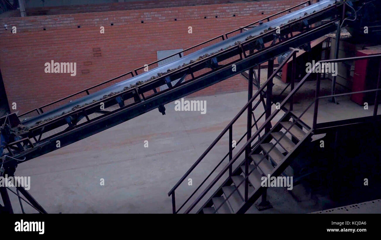 Industrial belt conveyor. Moving Raw Materials. Long conveyor belt transporting ore to the power plant. Extraction - Stock Image
