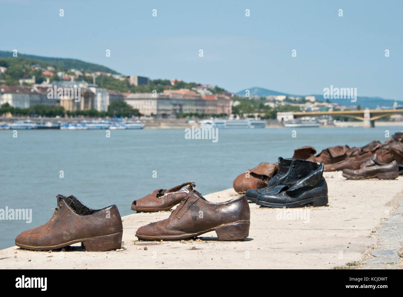 The Shoes on the Danube Bank memorial in Budapest on a sunny day. - Stock Image