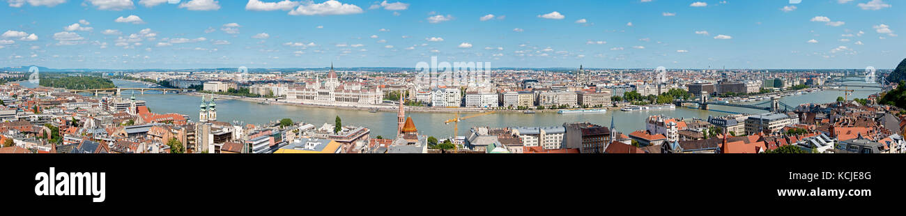 A 7 picture stitch panoramic aerial cityscape view of the Danube River in Budapest on a sunny day and blue sky. Stock Photo